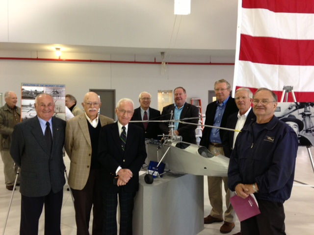 Sikorsky Aircraft retirees gather around a 1/4 scale model of the VS-300