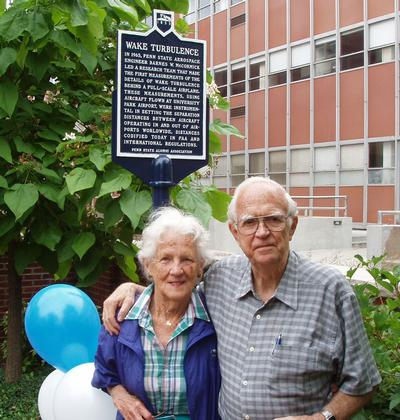 Emily and Barney McCormick in front of the wake turbulence historical marker